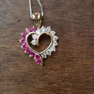 Silver heart pendent with pink stones